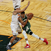ORLANDO, FL - JANUARY 11:  Giannis Antetokounmpo #34 of the Milwaukee Bucks drives to the net as Aaron Gordon #00 of the Orlando Magic defends at Amway Center on January 11, 2021 in Orlando, Florida. NOTE TO USER: User expressly acknowledges and agrees that, by downloading and or using this photograph, User is consenting to the terms and conditions of the Getty Images License Agreement. (Photo by Alex Menendez/Getty Images)*** Local Caption *** Giannis Antetokounmpo; Aaron Gordon