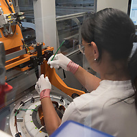 Employee works on assembling an E-Engine production starts at the Audi factory in Gyor (about 120 km West of Budapest), Hungary on July 24, 2018. ATTILA VOLGYI