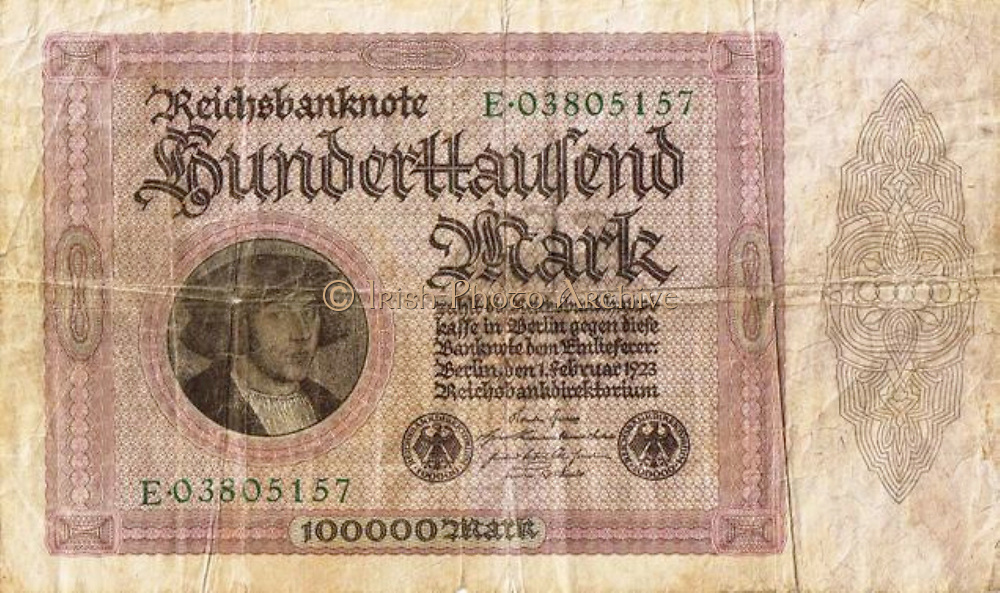 Hyperinflation in Germany after World War I. Hundred thousand Reichsmark note, 1923.