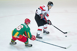 Sarunas Suchomlinas of Lithuania vs Konstantin Komarek of Austria  during the ice hockey match between National teams of Lithuania (LTU) and Austria (AUT) at 2011 IIHF World U20 Championship Division I - Group B, on December 12, 2010 in Ice skating Arena, Bled, Slovenia.  (Photo By Vid Ponikvar / Sportida.com)