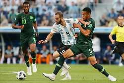 June 26, 2018 - Saint Petersburg, Russia - William Ekong (R) of Nigeria national team and Gonzalo Higuain of Argentina national team vie for the ball during the 2018 FIFA World Cup Russia group D match between Nigeria and Argentina on June 26, 2018 at Saint Petersburg Stadium in Saint Petersburg, Russia. (Credit Image: © Mike Kireev/NurPhoto via ZUMA Press)