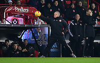 Sheffield United manager Chris Wilder retrieves the ball as it goes out of play<br /> <br /> Photographer Chris Vaughan/CameraSport<br /> <br /> The EFL Sky Bet League One - Sheffield United v Fleetwood Town - Tuesday 24th January 2017 - Bramall Lane - Sheffield<br /> <br /> World Copyright © 2017 CameraSport. All rights reserved. 43 Linden Ave. Countesthorpe. Leicester. England. LE8 5PG - Tel: +44 (0) 116 277 4147 - admin@camerasport.com - www.camerasport.com