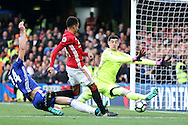 Jesse Lingard of Manchester United shoots at goal but is denied by a save by Chelsea goalkeeper Thibaut Courtois . Premier league match, Chelsea v Manchester Utd at Stamford Bridge in London on Sunday 23rd October 2016.<br /> pic by John Patrick Fletcher, Andrew Orchard sports photography.