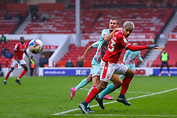 Lyle Taylor of Nottingham Forest is shackled by Ryan Bennett of Swansea City  - Mandatory by-line: Nick Browning/JMP - 29/11/2020 - FOOTBALL - The City Ground - Nottingham, England - Nottingham Forest v Swansea City - Sky Bet Championship
