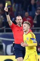 ROMANIA, Bucharest: Referee Jonas Eriksson (L) shows a yellow card to Romania's Alexandru Maxim (R) during the Euro 2016 Group F qualifying football match Romania vs Northern Ireland in Bucharest, Romania on November 14, 2014.