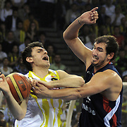 Fenerbahce Ulker's Mirsad TURKCAN (L) and Efes Pilsen's Kaya PEKER (R) during their Turkish Basketball league Play Off Final third leg match Fenerbahce Ulker between Efes Pilsen at the Abdi Ipekci Arena in Istanbul Turkey on Tuesday 25 May 2010. Photo by TURKPIX