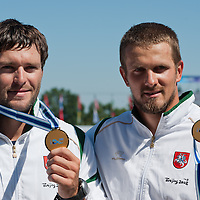 Tomas Gadeikis (L) and Raimundas Labuckas (R) from Lithuania celebrate their victory in the C2 men Canoe 200m final of the 2011 ICF World Canoe Sprint Championships held in Szeged, Hungary on August 21, 2011. ATTILA VOLGYI