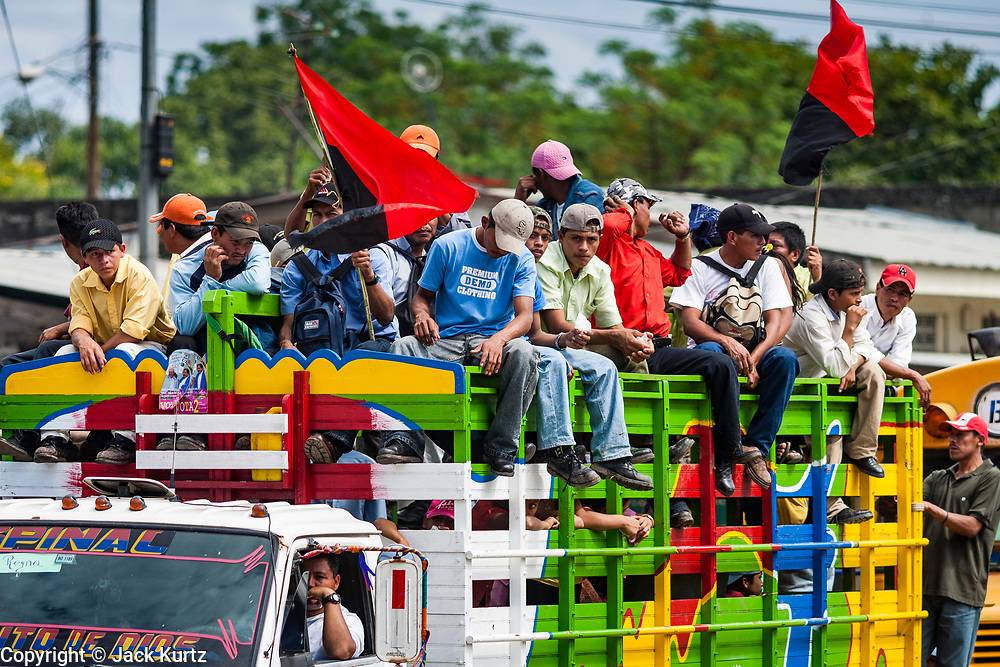 """10 JANUARY 2007 - MANAGUA, NICARAGUA: Sandanista supporters from the Nicaraguan countryside roll into Managua to witness the inauguration of Daniel Ortega. Ortega, the leader of the Sandanista Front, was sworn in as the President of Nicaragua Wednesday. Ortega and the Sandanistas ruled Nicaragua from their victory of """"Tacho"""" Somoza in 1979 until their defeat by Violetta Chamorro in the 1990 election.  Photo by Jack Kurtz"""