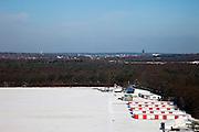 Nederland, Noord-Holland, Gemeente Hilversum, 31-01-2010; vliegveld Hilversum in de sneeuw, boven de bomen de toren van het raadhuis en de Vituskerk.Hilversum airfield in the snow.luchtfoto (toeslag), aerial photo (additional fee required).foto/photo Siebe Swart