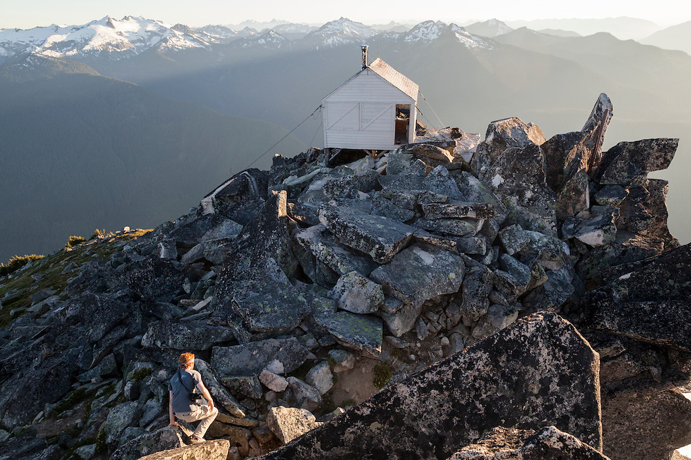 Stephen Byrne hikes to the fire lookout cabin on the summit of Hidden Lake Peaks, North Cascades National Park, Washington.