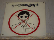 "A sign saying ""No Smiling or Laughing""   above the door leading into the Museum.<br /> The Toui Sleng Genocide Museum. The Toui Sleng was a college turned into interrogation and torture centre by the Khmer Rouge during their rule in the seventies, called S21 by the Khmer Rouge. Most inmates were murdere, either they died during torture or in the Klling Fields outside Phnom Penh. An estimated 17,000 prisoners were held at the prison, called S21 by the Khmer Rouge and only 7 is believed to have survived imprissonment, the rest died either in prison or were killed in the Killing Fields.<br /> The Toui Sleng prison was run by Kang Kek Iew, Comrade Duch, a former school teacher. On 26 July 2010, Duch was found guilty of crimes against humanity, torture, and murder; he was sentenced to 35 years' imprisonment"