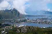 View from Tjeldbergtind 367m of the town of Svolvaer on 21st August 2016, Lofoten Islands, Norway. The Lofoten islands are famous for their jagged mountains, red-painted rorbu cabins and racks with fish hanging closely packed to dry.