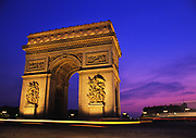 Arc de Triomphe, Paris, France at night with cars passing by