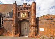 Red brick Tudor gateway Wolsey's Gate, Ipswich, Suffolk, England, UK - Cardinal Thomas Wolsey 1530s
