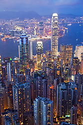 Evening view of spectacular skyline of Hong Kong with Victoria Harbour to the rear