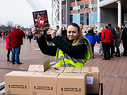 A programme seller outside if the stadium <br /> <br /> Photographer Simon King/Replay Images<br /> <br /> Six Nations Round 3 - Wales v England - Saturday 23rd February 2019 - Principality Stadium - Cardiff<br /> <br /> World Copyright © Replay Images . All rights reserved. info@replayimages.co.uk - http://replayimages.co.uk