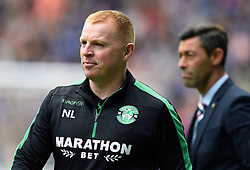 File photo dated 24/07/13 of Hibernian manager Neil Lennon (front). Police have received complaints over Neil Lennon's conduct during a football match at the weekend.