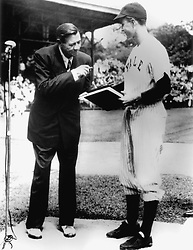 """New Haven, Connecticut - Undated file photo -- On behalf of Yale University, Yale Baseball Captain George Bush accepts """"The Babe Ruth Story"""" autobiography from Babe Ruth in 1948. Photo by White House via CNP/ABACAPRESS.COM"""