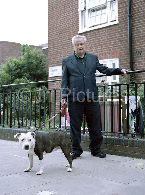 Dave Hoefling, with his dog, in Somers Town on 1st July 2016 in London, United Kingdom. Somers Town, a district in north west London, is a large housing estate nestled between Euston, St Pancras and Kings Cross Library. Predominantly filled with social housing for the past 200 years, much of the area's housing was built in the twentieth century by the local authority.