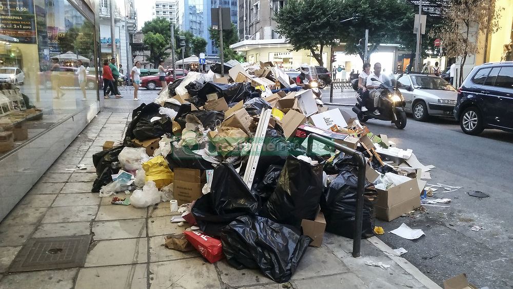 June 26, 2017 - Thessaloniki, Greece - 10.000 short contract municipal workers are protesting with a continuous strikes for more than a week, leaving the whole country's garbage on the street demanding the extension of their contract. Authorities asked people to keep their trash at home as there are issues with public health due to the increased high temperature as the country is facing a heatwave. Municipality of Thessaloniki is trying to resolve the situation by turning to the private sector, a move that is against the will of the municipal labour unions. In Thessaloniki tourists avoid the main squares and popular streets as the smell and the view of the city is disgusting. (Credit Image: © Nicolas Economou/NurPhoto via ZUMA Press)