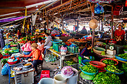 Nov., 2020, Hoi an: Fresh colorful vegetables, fish, chicken, duck on sale. This is a covered area next to the Thu bon river. Mostly Vietnamese women work under this open air roofed building by Central Market. RAW to Jpg.