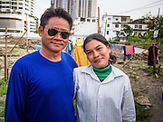 05 SEPTEMBER 2013 - BANGKOK, THAILAND:  Cambodian workers pose for a portrait after their shift at the construction site of a new high rise apartment / condominium building on Soi 22 Sukhumvit Rd in Bangkok. The workers live in the corrugated metal dorms on the site. Most of the workers at the site are Cambodian immigrants.             PHOTO BY JACK KURTZ