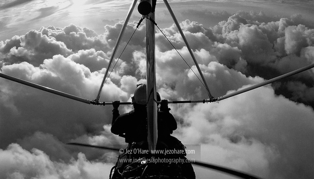 Jez O'Hare flying his trike microlight from Buton to the Tukang Besi Islands, Sulawesi Tenggara, Indonesia.