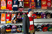 Wu Pengxu, owner of  the Yiwu Wells Knitting Products Co., Ltd factory, poses in his showroom weraing Arsenal cap and scarf in Yiwu, Zhejiang Province, China on 06 March  2013. The city of Yiwu is known as one of China's largest trading centers for small merchandise and light industry, drawing buyers from around the world. Uncertain global demand, a stronger yuan currency and rising labour costs have taken their toll on Chinese exporters, but analysts believe sales could pick up modestly in 2014 due to improved demand from the United States and Europe.