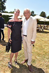 Derek Bell and Misti Bell at the 'Cartier Style et Luxe' enclosure during the Goodwood Festival of Speed, Goodwood House, West Sussex, England. 15 July 2018.