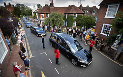© Licensed to London News Pictures. 10/07/2020. Ditchling, UK. The funeral cortege carrying the body of WWII Forces' Sweetheart Dame Vera Lynn passes through her home village  Ditchling, East Sussex. The cortege will head to a crematorium in Brighton for a private funeral. A Battle of Britain Memorial Flight flypast, consisting of a Spitfire and a Hurricane, will perform a flypast at noon. Photo credit: Peter Macdiarmid/LNP