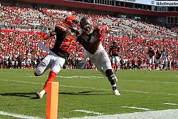 October 21, 2018 - Tampa, FL, U.S. - TAMPA, FL - OCT 21: O. J. Howard (80) of the Bucs makes a catch and is stopped just short of the end zone by Derrick Kindred (26) of the Browns during the regular season game between the Cleveland Browns and the Tampa Bay Buccaneers on October 21, 2018 at Raymond James Stadium in Tampa, Florida. (Photo by Cliff Welch/Icon Sportswire) (Credit Image: © Cliff Welch/Icon SMI via ZUMA Press)