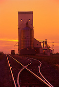 Railroad tracks and grain elevator at sunset<br /> Wolseley<br /> Saskatchewan<br /> Canada