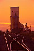 Railroad tracks and grain elevator at sunset<br /> Wolseley<br /> Saskatchewan<br /> Canada