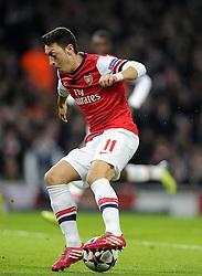 Arsenal's Mesut Ozil - Photo mandatory by-line: Joe Meredith/JMP - Tel: Mobile: 07966 386802 19/02/2014 - SPORT - FOOTBALL - London - Emirates Stadium - Arsenal v Bayern Munich - Champions League - Last 16 - First Leg