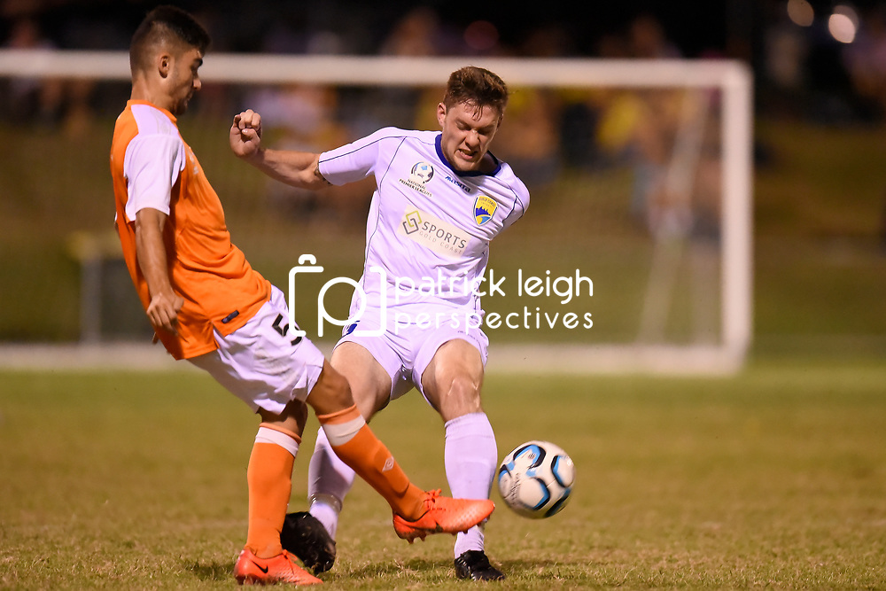 BRISBANE, AUSTRALIA - FEBRUARY 10: Matthew Crooks of the Roar is fouled by Brandon Reeves of United during the NPL Queensland Senior Mens Round 2 match between Gold Coast United and Brisbane Roar Youth at Station Reserve on February 10, 2018 in Brisbane, Australia. (Photo by Football Click / Patrick Kearney)