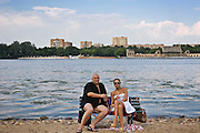 Moscow, Russia, 08/07/2005..Couple at the Pokrovka Bereg Beach Club on the Moscow River.