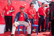 """Mar. 26, 2009 -- BANGKOK, THAILAND: Veera Musigapong, a leader of the United Front of Democracy Against Dictatorship (UDD), waits to speak at a UDD rally in Bangkok Thursday. Veera was a deputy leader of former Prime Minister Thaksin Shinawatra's party. More than 30,000 members of the United Front of Democracy Against Dictatorship (UDD), also known as the """"Red Shirts""""  and their supporters descended on central Bangkok Thursday to protest against and demand the resignation of current Thai Prime Minister Abhisit Vejjajiva and his government. Abhisit was not at Government House Thursday. The protest is a continuation of protests the Red Shirts have been holding across Thailand in March.  Photo by Jack Kurtz  PHOTO BY JACK KURTZ"""