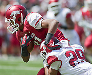 Apr 20, 2013; Fayetteville, AR, USA; Arkansas Razorback red wide receiver Mekale McKay (82) is brought down by Arkansas Razorback white cornerback Jared Collins (29) during the red vs. white spring football game at Donald W. Reynolds Razorback Stadium. Mandatory Credit: Beth Hall-USA TODAY Sports