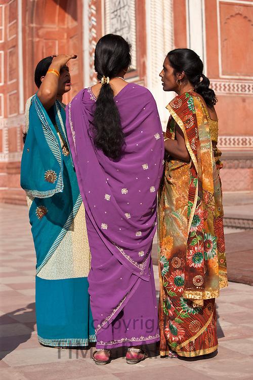 Indian women at South Gate of The Taj Mahal, Darwaza-i rauza in Uttar Pradesh, India