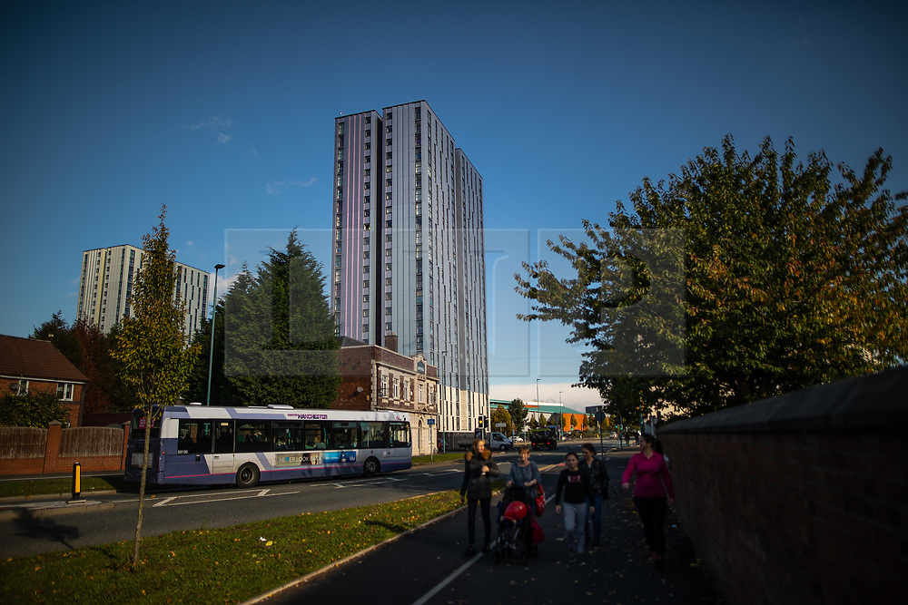 © Licensed to London News Pictures . 11/10/2018. Salford , UK . GV of Thorn Court (c) and Spruce Court (l). Recently installed cladding at several council-owned tower blocks in Salford has been identified as having similar dangerous properties to that which was installed on the Grenfell Tower in London . Residents have been waiting months for clarification on what action will be taken to make their homes safe . Photo credit : Joel Goodman/LNP