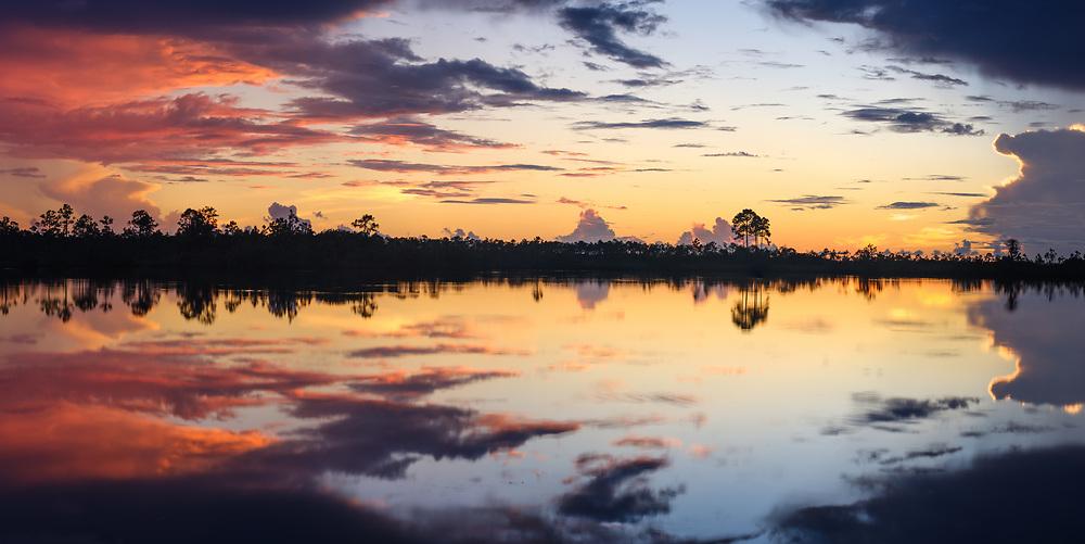 MIAMI, FLORIDA - CIRCA SEPTEMBER 2018:  Panoramic view of a sunset over the Florida Everglades near Miami.