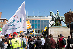 © Licensed to London News Pictures. 10/7/2014. Coventry, Warwickshire, UK. Hundreds of public sector workers held a demonstration in Coventry today. Speeches in Broadgate under the statue of Lady Godiva were followed by a march through the City Centre. Pictured, the demonstration in Broadgate. Photo credit : Dave Warren/LNP