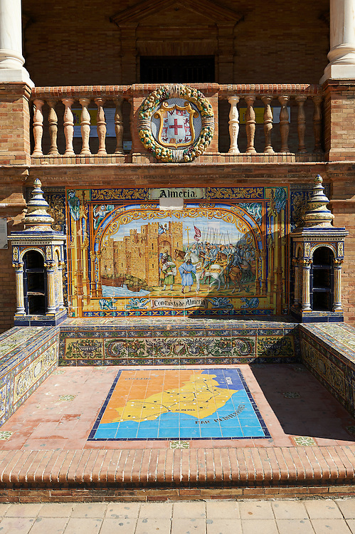 The Almera tiled Alcove along the walls of the Plaza de Espana in Seville built in 1928 for the Ibero-American Exposition of 1929, Seville Spain . The Royal Alcázars of Seville (al-Qasr al-Muriq ) or Alcázar of Seville, is a royal palace in Seville, Spain. It was built by Castilian Christians on the site of an Abbadid Muslim alcazar, or residential fortress.The fortress was destroyed after the Christian conquest of Seville The palace is a preeminent example of Mudéjar architecture in the Iberian Peninsula but features Gothic, Renaissance and Romanesque design elements from previous stages of construction. The upper storeys of the Alcázar are still occupied by the royal family when they are in Seville. <br /> <br /> Visit our SPAIN HISTORIC PLACES PHOTO COLLECTIONS for more photos to download or buy as wall art prints https://funkystock.photoshelter.com/gallery-collection/Pictures-Images-of-Spain-Spanish-Historical-Archaeology-Sites-Museum-Antiquities/C0000EUVhLC3Nbgw <br /> .<br /> Visit our MEDIEVAL PHOTO COLLECTIONS for more   photos  to download or buy as prints https://funkystock.photoshelter.com/gallery-collection/Medieval-Middle-Ages-Historic-Places-Arcaeological-Sites-Pictures-Images-of/C0000B5ZA54_WD0s