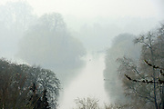 © Licensed to London News Pictures. 13/03/2014. Richmond, UK Fog lingers of the River Thames in Richmond, Surrey, today 13th March 2014. Photo credit : Stephen Simpson/LNP