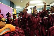 Christ the King Jesuit College Preparatory School founding students celebrate in the halls before the school's First Commencement Exercises on Saturday, June 9th 2012. The institution is a beacon of hope amid one of the city's most impoverished neighborhoods, bucking low graduation rate trends with a 100% graduation and college acceptance rate. Brian J. Morowczynski~ViaPhotos..For use in a single edition of Catholic New World Publications, Archdiocese of Chicago. Further use and/or distribution may be negotiated separately. ..Contact ViaPhotos at 708-602-0449 or email brian@viaphotos.com.