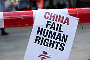 China human rights fail poster as part of a protest in the city centre on 14th July 2021 in Birmingham, United Kingdom. The protest was led by China Labour Solidarity, with solidarity with the Uyghur people and calling for boycott on the Beijing 2022 Olympics.