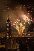 Fireworks explode over the San Felipe Neri church in the colonial center on the stoke of midnight celebrating the New Year January 1, 2018 in San Miguel de Allende, Mexico.