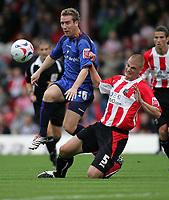 Photo: Lee Earle.<br /> Brentford v Bradford City. Coca Cola League 1. 02/09/2006. Bradford's David Graham (L) clashes with Matt Heywood.
