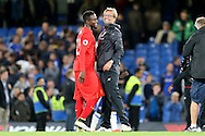 Jurgen Klopp, the Liverpool manager celebrates after the final whistle with Divock Origi of Liverpool. Premier league match, Chelsea v Liverpool at Stamford Bridge in London on Friday 16th September 2016.<br /> pic by John Patrick Fletcher, Andrew Orchard sports photography.