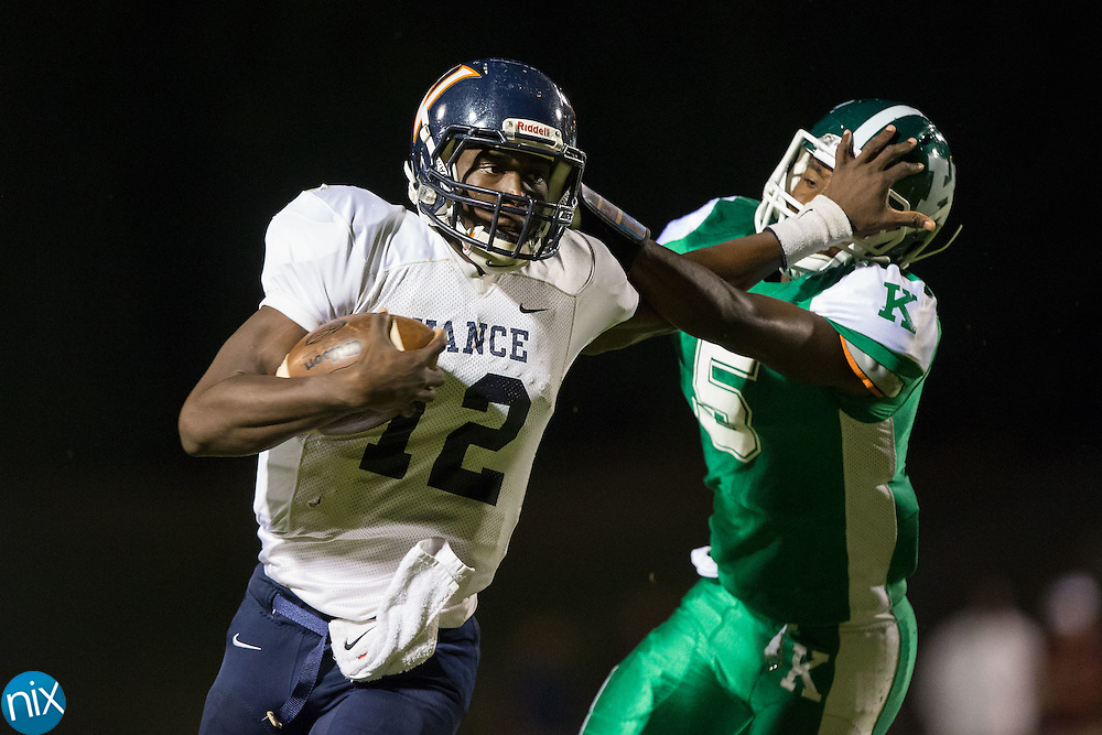 Kingsley Ifedi (12) of the Vance Cougars stiff arms Cinsere Allison (5) of the A.L. Brown Wonders as he runs with the football at A.L. Brown High School on September 30, 2016 in Kannapolis, North Carolina.  The Wonders defeated the Cougars 24-21.  (Brian Westerholt/Special to the Tribune)